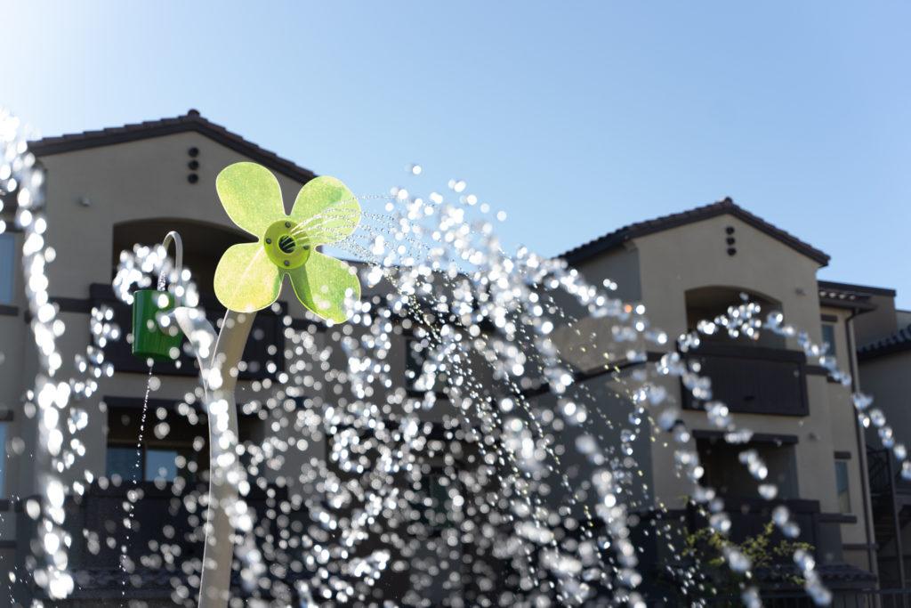 community splash pad with large flowers spraying water